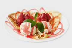 Ice cream with strawberry jam decorated with mint leaf closeup s Stock Photo