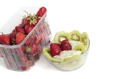 Ice cream and strawberry. Plastic, transparent box with strawberry and ice cream - a dessert Royalty Free Stock Image