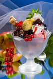 Ice cream studio with fruits. Ice cream chalice with fruits Royalty Free Stock Photography