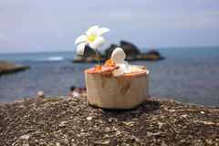 Ice cream on summer coconut with orchid flower. On the tropical beach Royalty Free Stock Images