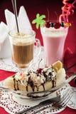 Ice Cream Sundae, Banana Split, milkshake and coctail. Dessert of banana split with ice cream and whipped cream, strawberry milkshake and coffee and milk coctail Royalty Free Stock Photos