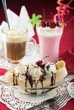 Ice Cream Sundae, Banana Split, milkshake and coctail. Dessert of banana split with ice cream and whipped cream, strawberry milkshake and coffee and milk coctail Royalty Free Stock Photography