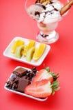 Ice cream sundae, chocolate and sliced fruits Royalty Free Stock Photo