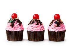 Ice cream sundae cupcakes. Row of ice cream sundae cupcakes on white royalty free stock photos