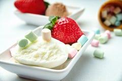 Ice cream sundae, strawberry and candies Stock Photo