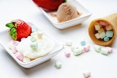 Ice cream sundae, strawberry and candies Stock Photos