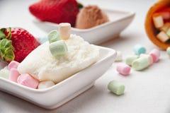 Ice cream sundae, strawberry and candies Stock Images