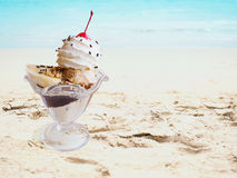Ice cream sundae on summer sand beach stock images