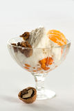 Ice cream with tangerine and nut Stock Photography