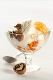 Ice cream with tangerine, nut and spoon. Ice cream with tangerine, nuts, berries and spoon Royalty Free Stock Photo