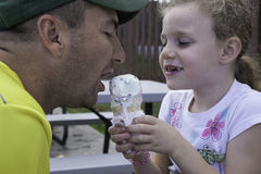 Ice Cream Time - Sharing with Daddy Royalty Free Stock Photography