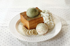 Ice cream and toasted bread Royalty Free Stock Photos