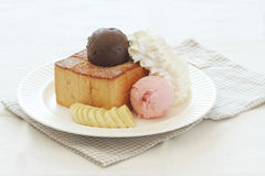 Ice cream and toasted bread with banana Stock Images