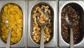 Ice Cream Toppings. Cereals, cashew nut and chocolate rainbow Royalty Free Stock Images