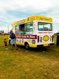 An ice cream van with a mother and child customers Royalty Free Stock Image