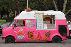Pink ice cream van vintage. A pink Ford Transit van parked at Hyde Park in Sydney, Australia, with window open, ready to sell sweets Royalty Free Stock Photos