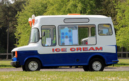 Ice cream van. Side view of ice cream van in green countryside Stock Photography