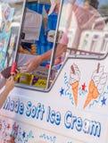 Ice cream van vendor selling ice cream stock image