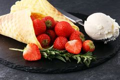 Ice cream vanilla flavor and cones with fresh strawberry setup o Royalty Free Stock Photo