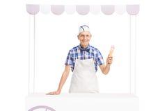 Ice cream vendor holding an ice cream cone Stock Photo