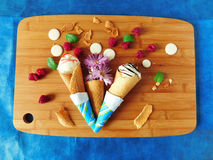 Ice cream in waffle cones. Waffle cones with an ice cream, berries and syrup stock photography