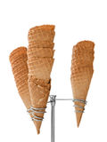 Ice cream waffle cones on dispenser isolated on white Royalty Free Stock Photos