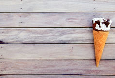Ice cream in a waffle cones over wooden background with copy spa Royalty Free Stock Images