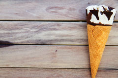 Ice cream in a waffle cones over wooden background with copy spa Stock Images