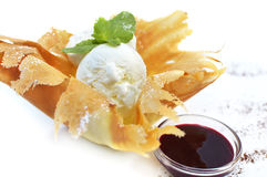 Ice cream in waffle with sauce Royalty Free Stock Images