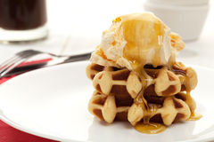 Ice cream and waffles with syrup Royalty Free Stock Photo