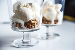 Ice cream with walnuts in a glass. Ice cream ball with walnut Stock Photo