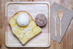 Ice creams and almond slice on toast Royalty Free Stock Image