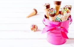 Ice creams in the basket Stock Photos