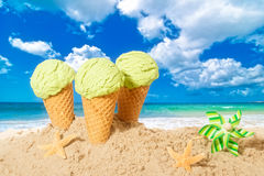 Ice Creams. Minty flavor icecreams with pinwheel on summer beach Royalty Free Stock Photo