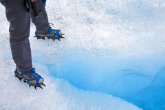 Ice Crevasse - Crampons - Patagonia - Chile. Standing over a crevasse on the Grey Glacier in Torres Del Paine National Park in the Andes Mountains of Patagonia Stock Images