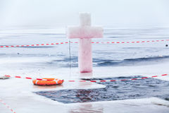 Ice cross and hole in winter pond on Epiphany Royalty Free Stock Photography