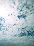 Ice crystal clouds covering the blue sky royalty free stock photos