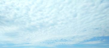 Ice crystal clouds covering the blue sky royalty free stock photography