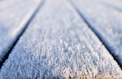 Ice crystals. Hoar frost ice crystals on boards Royalty Free Stock Image