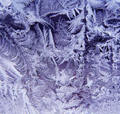 ICE CRYSTALS. Ice patterns on frosty window Stock Photo