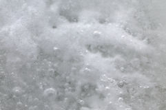 Ice crystals. Snow on the ice. Abstract background. Close-up Stock Photography