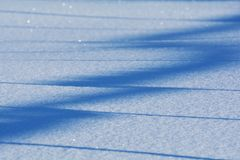 Ice crystals on a blue blurred snowy background Stock Image