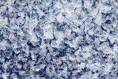 Ice crystals on a dark colored background Royalty Free Stock Photos