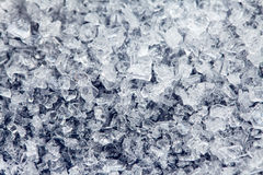 Ice crystals of frozen water on a dark surface. Fine ice crystals of frozen water on a dark surface Royalty Free Stock Photos