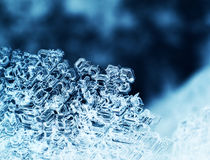 Ice crystals macro. Snowflake ice crystals macro closeup dark blue background Royalty Free Stock Photography