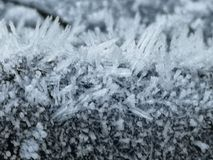 Ice crystals on a motorbikes petrol tank. Oznor ice crystals motorbikes petrol tank snow freezing winter cold minus celsius royalty free stock photo