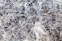 Ice crystals over frozen puddle Stock Photography