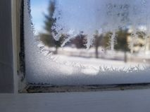 Ice crystals in window stock photography