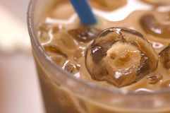 Ice Cube. In milk tea Royalty Free Stock Photo