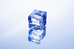 Ice cube. Transparent ice cube on a mirrored background Royalty Free Stock Photos